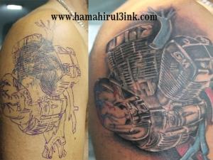Tatuaje motor cover up en el brazo