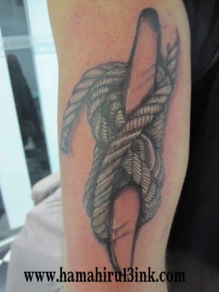 Tatuaje Brazo Hamahiru 13 Ink Tattoo & Piercing