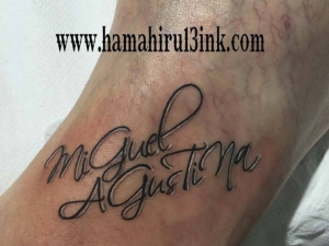 Tatuaje lettering y corazones